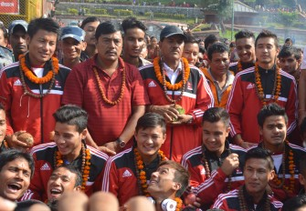 Nepal football team lines up for a group photograph in the Pashupatinath Temple premise on Sep 8, 2013.