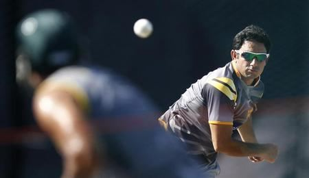 Pakistan's Saeed Ajmal bowls during a practice session ahead of their Twenty20 World Cup semi-final match against Sri Lanka in Colombo, October 3, 2012. REUTERS/Dinuka Liyanawatte